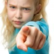 Angry girl is pointing — Stock Photo