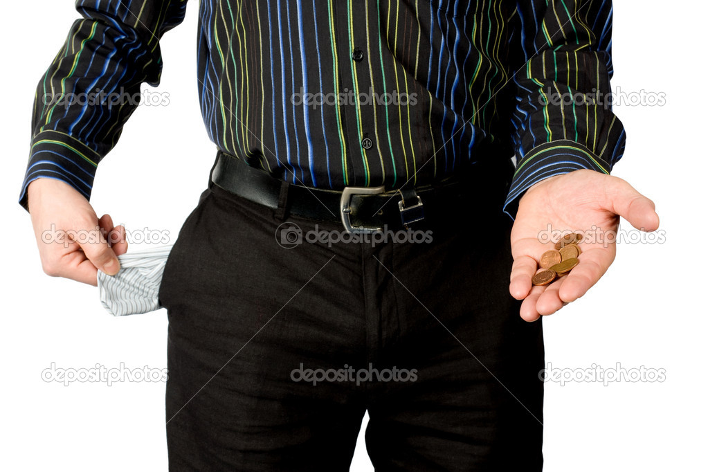 Man shows empty pocket and little money isolated on white background  Stock Photo #2532468