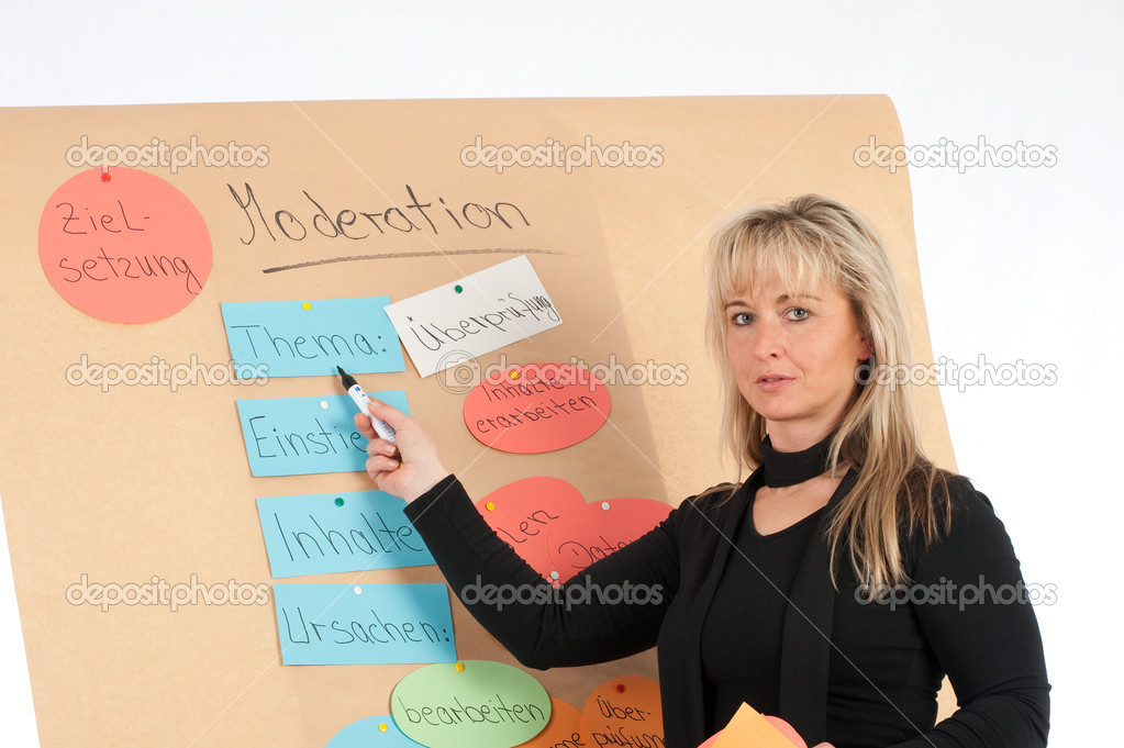 Educates young presenter on a flip chart — Stock Photo #2180024