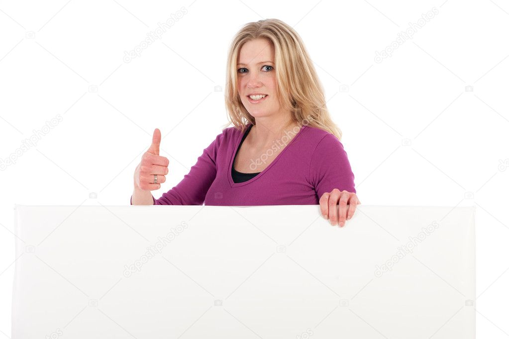 Young blond woman shows space for text — Stock Photo #2480318