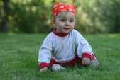 Child in the grass — Stock Photo