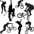 Skateboarding and bicyclist silhouette v — Stock Vector