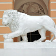 White lion sculpture on pedestal - Stock Photo