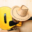 Classical guitar, hat and harmonica - Stock Photo