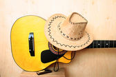 Classical guitar, hat and harmonica — Stock Photo