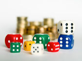 Dices and coins — Stock Photo