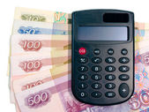 Calculator and paper money — Stock Photo