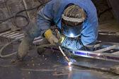 The welder behind work — Stock Photo