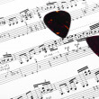 Guitar music sheet with pick — Stock Photo
