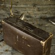Stock Photo: Old worn out suitcase