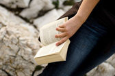 Book in hand — Stock Photo