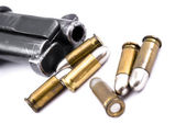 Pistol and bullets — Stock Photo