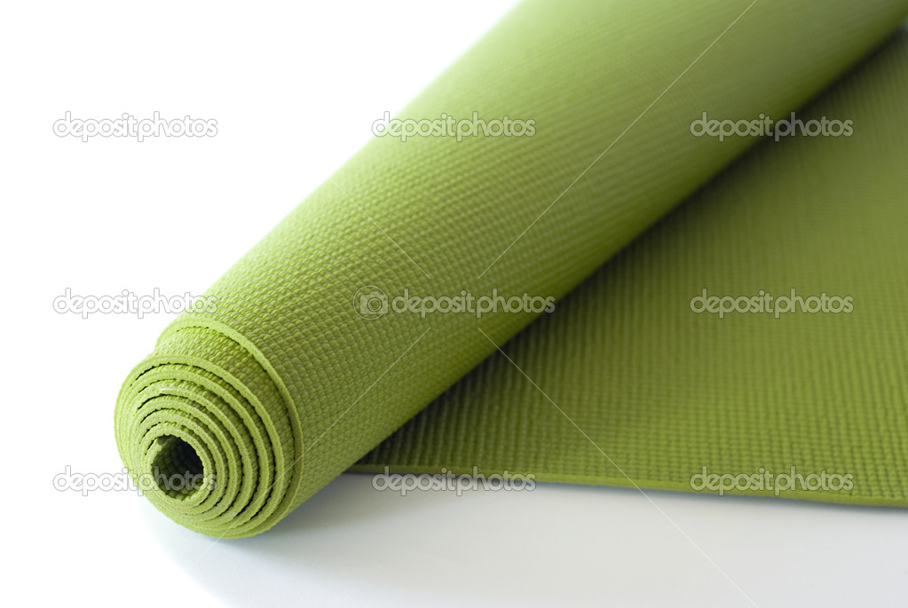 A green yoga/pilates/exercise mat rolled up on white. — Stock Photo #2436789