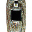 Mobile phone encrusted with crystals - Stock Photo