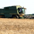 Combine at farmland — Stock Photo