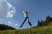 Young happy attractive female jumping — Stock Photo