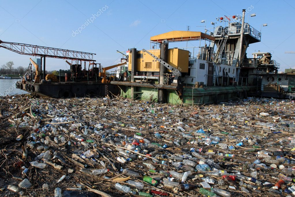 Dangerous industrial toxic garbage floating in river with other pollute waste  Stock Photo #2315495