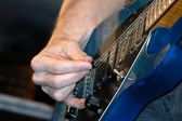 Guitarist playing a guitar — Stock Photo