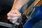 Guitarist playing a guitar — Stock Photo