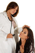 Attractive female doctor and patient — Stock Photo