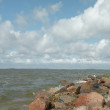 Stock Photo: Sea, stones and cloudy sky