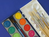 Watercolors and brush — Stock Photo