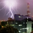 Lightning and office building — Stock Photo
