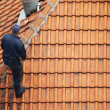 Roofer doing repair - Stock Photo
