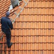 Stock Photo: Roofer doing repair