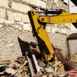 Yellow digger demolition — Stock Photo