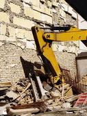 Yellow digger demolition — Stock Photo