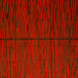 Bamboo cane wall with red background — Stock Photo