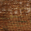 Bamboo and old fishing net - Stock Photo