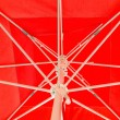 Stock Photo: Red parasol with white spokes detail