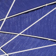 White spokes on blue sun umbrella — Stock Photo