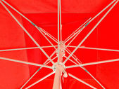 Red parasol with white spokes detail — Stock Photo