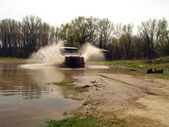 4x4 driving through river — Stock Photo