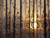 Sunset through window curtain — Stock Photo
