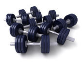 A group of dark blue dumbbells — Stock Photo