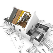 House with exposed roof layers and plans — Stockfoto