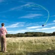 Man flying a kite — Stock Photo