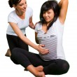 Yoga lesson for pregnant woman - Stock Photo