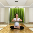 A young woman in the yoga lotus position — Stock Photo #2202463