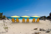 Yellow sunshade cove — Stock Photo