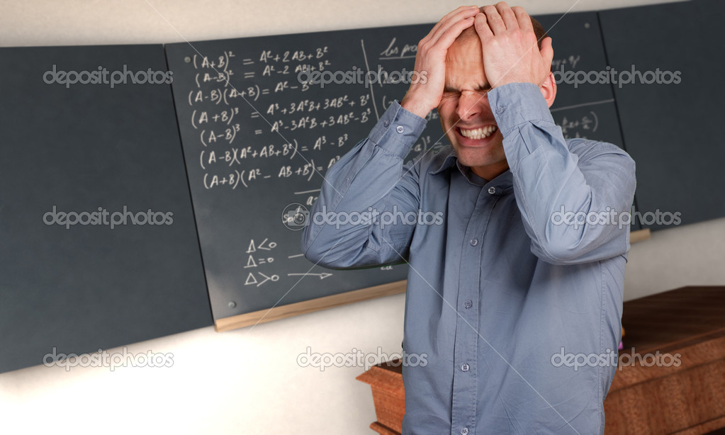 Desperate man in a class with complicated formulae in the blackboard  Stock Photo #2200132