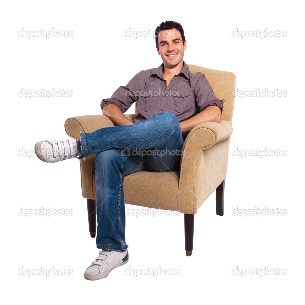young man sitting on a sofa stock photo franckito 2202576. Black Bedroom Furniture Sets. Home Design Ideas