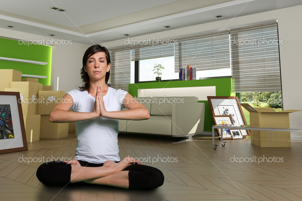 Woman in lotus position in her new home. The images of the pictures are mine, and the label information is made up, so no copyright issue. — Stock Photo #2202887