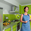 Smiling cook in a modern kitchen — Stock Photo