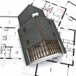House on blueprints with notes — Stock Photo
