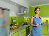 Smiling cook in a modern kitchen — Stockfoto